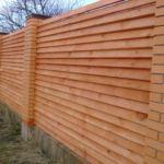 Забор из бруса елочка
