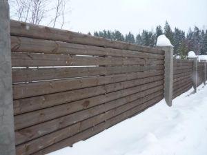 Прочный, надежный и долговечный забор из массивного бруса